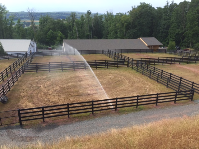 sprinkler system in horse pasture